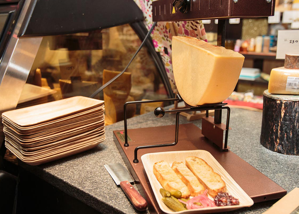 Fromagination serves Swiss Raclette hot meals during winter months.