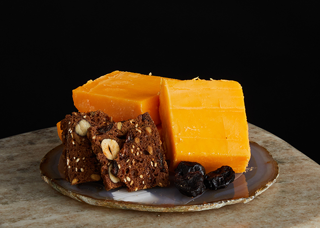 This is a picture of Hook's Ten-Year Aged Cheddar cheese, offered by Fromagination.