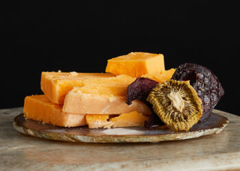 This is a picture of Hook's 12-Year Aged Cheddar cheese, offered by Fromagination.