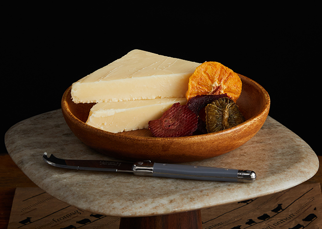 This is a picture of Hook's Eight-Year Aged Cheddar cheese, offered by Fromagination.