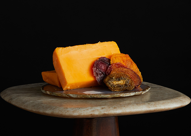 This is a picture of Hook's Five-Year Aged Cheddar cheese, offered by Fromagination.