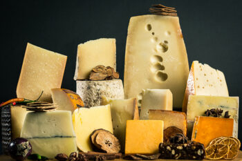 This is a picture of a display of Wisconsin artisan cheeses.