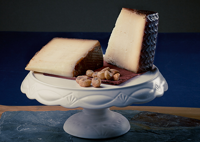 This is a picture of Wisconsin Manchego cheese, featured by Fromagination.