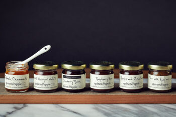 This is a picture of the Quince & Apple Six-Preserves Set from Fromagination.