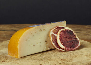 This is a picture Marieke Cumin Gouda cheese, offered by Fromagination