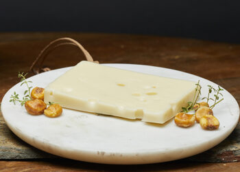 This is a picture of baby Swiss cheese, featured by Fromagination