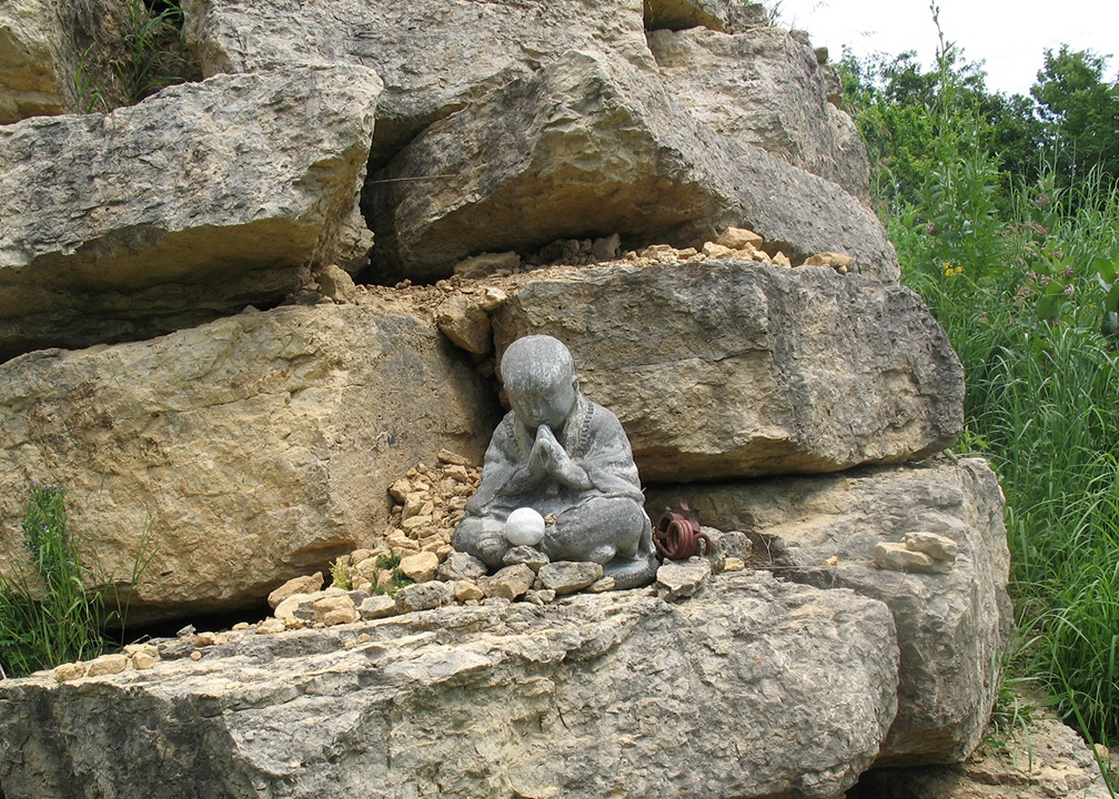 Buddha sits outside Bleu Mont Dairy's aging cave