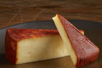 This is a picture of Apple Smoked Cheddar cheese, featured by Fromagination