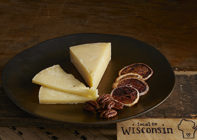 This is a picture of Bleu Mont Bandaged Cheddar cheese, featured by Fromagination.