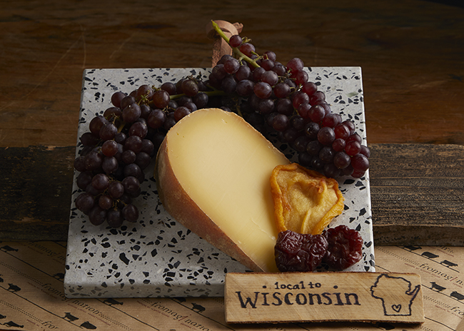 This is a picture of Pleasant Ridge Reserve cheese with fruit.