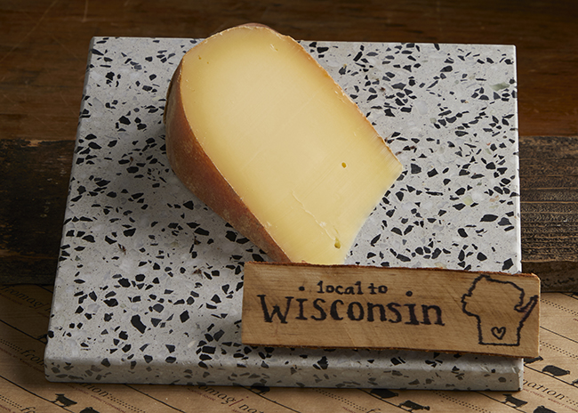 This is a picture of Pleasant Ridge Reserve cheese, featured by Fromagination.