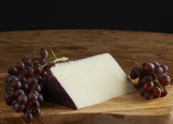 This is a picture of Boozin' Ewe cheese, featured by Fromagination