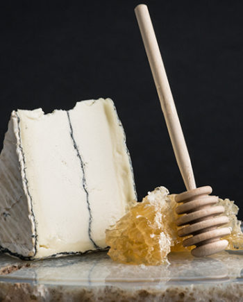 This is a picture of Humboldt Fog cheese with honey comb.