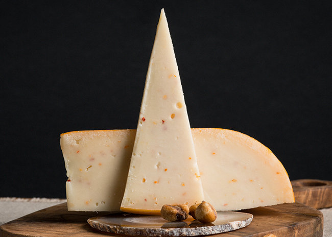 This is a picture of Marieke Garlic & Onion Gouda cheese, offered by Fromagination