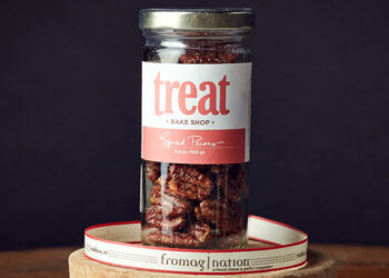 This is a picture of a jar of Treat Spiced Pecans.