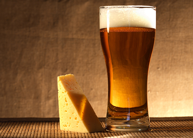 This is a picture of cheese and beer.