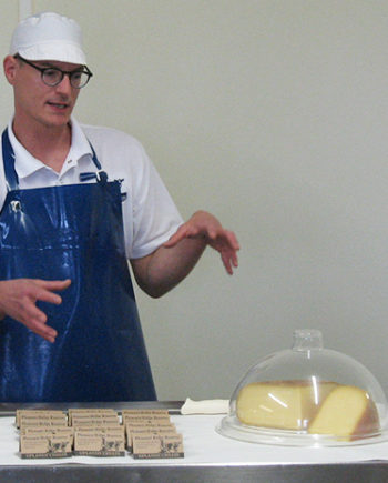 This is picture of a cheesemaker at Uplands Cheese in Dodgeville, Wisconsin.