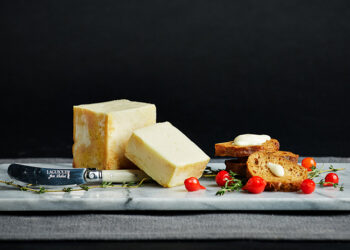 This is a picture of Limburger cheese, featured by Fromagination.