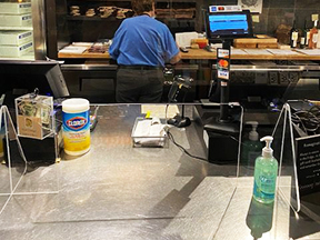 This is a picture of a Fromagination COVID-19 precaution at the checkout counter