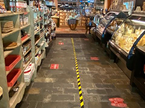 This is a picture of a Fromagination COVID-19 distancing in the shop