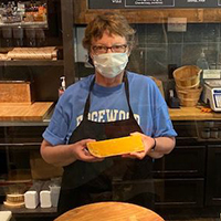 this is a picture of a masked Fromagiination cheesemonger