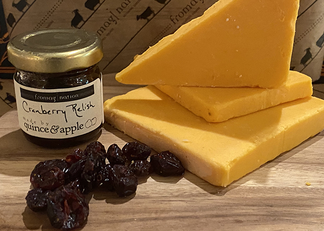 This is a picture of Hook's 10-Year Aged Cheddar cheese, featured at Fromagination