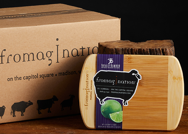 This is a picture of a bamboo cutting board, offered by Fromagination.
