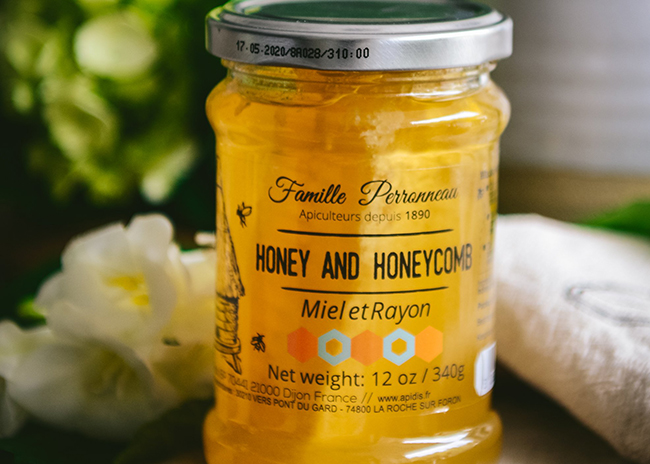 This is a picture of acacia honey with honeycomb.