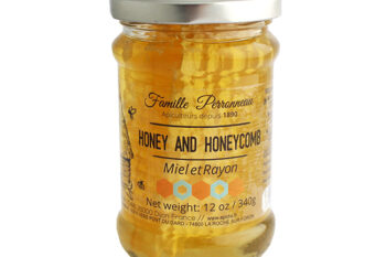 This is a picture of acacia honey with honeycomb offered by Fromagination.