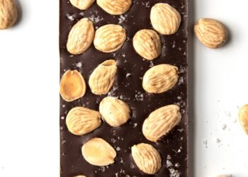 This is an image of the Marcona Almond bar surrounded by almonds.