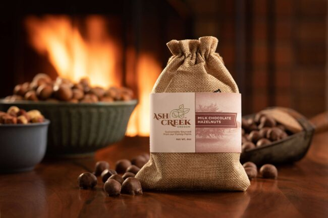 This is an image of milk chocolate hazelnuts in front of a fire.