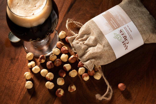 This is an image of roasted hazelnuts by a stout