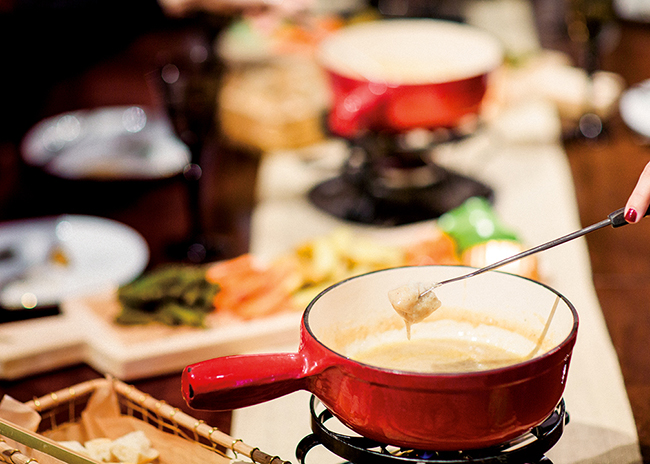 This is a picture of a fondue fork and fondue pot from Fromagination's Fondue at Home class.
