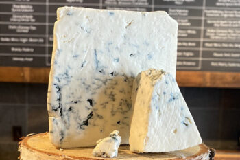 This is a picture of Buttermilk Blue Affinee cheese, featured at Fromagination.