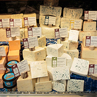 This is a picture of a Fromagination cheese case