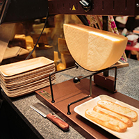This is a picture of a raclette cheese grill at Fromagination