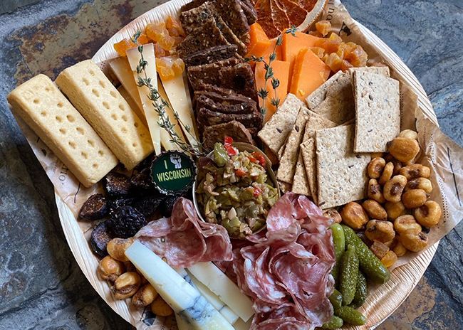 This is a picture of Fromagination's Graduation Cheese & Charcuterie Tray