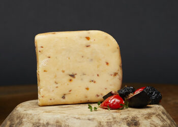 This is a picture of Three Chili Pepper Gouda cheese, featured at Fromagination.