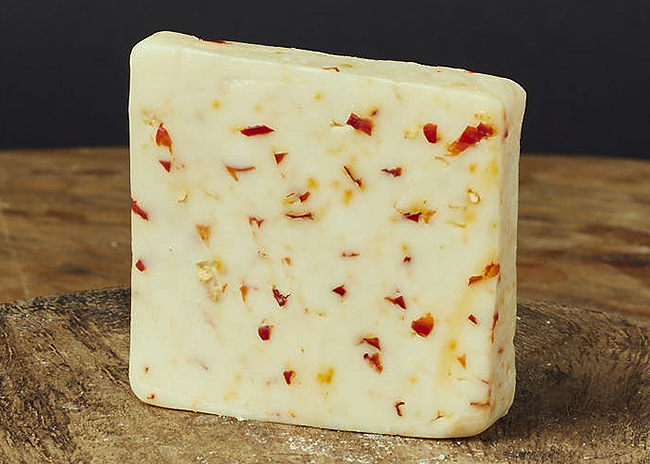 This is a picture of Hook's Goat Milk Pepper Jack cheese, offered by Fromagination