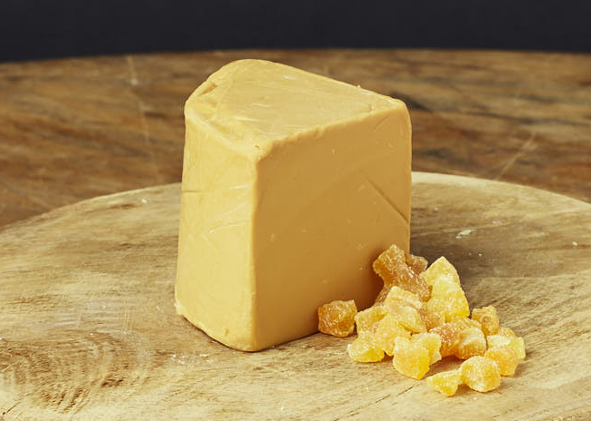 This is a picture of Norwegian Gjetost cheese, featured at Fromagination.