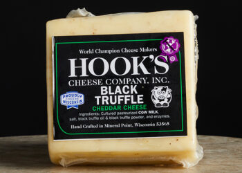 This is a picture of Hook's Black Truffle Cheddar cheese, offered by Fromagination.