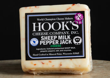 This is a picture of Hook's Sheep Milk Pepper Jack cheese, offered by Fromagination.