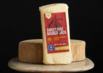 This is a picture of Sweet Fire Mango Jack cheese, offered by Fromagination.