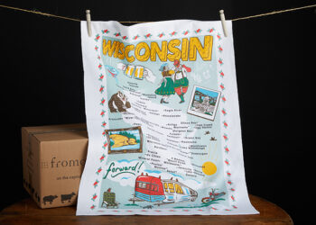 This is a picture of a Wisconsin Travels Towel, offered by Fromagination.