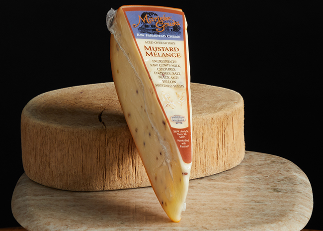 This is a picture of Marieke Mustard Melange Gouda cheese, offered by Fromagination.